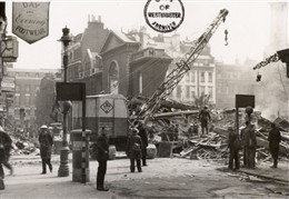 Photo:Black and white photograph of Old Compton Street showing damage to the church of St Anne, Soho, (bomb incident number 1522), 11 May 1941